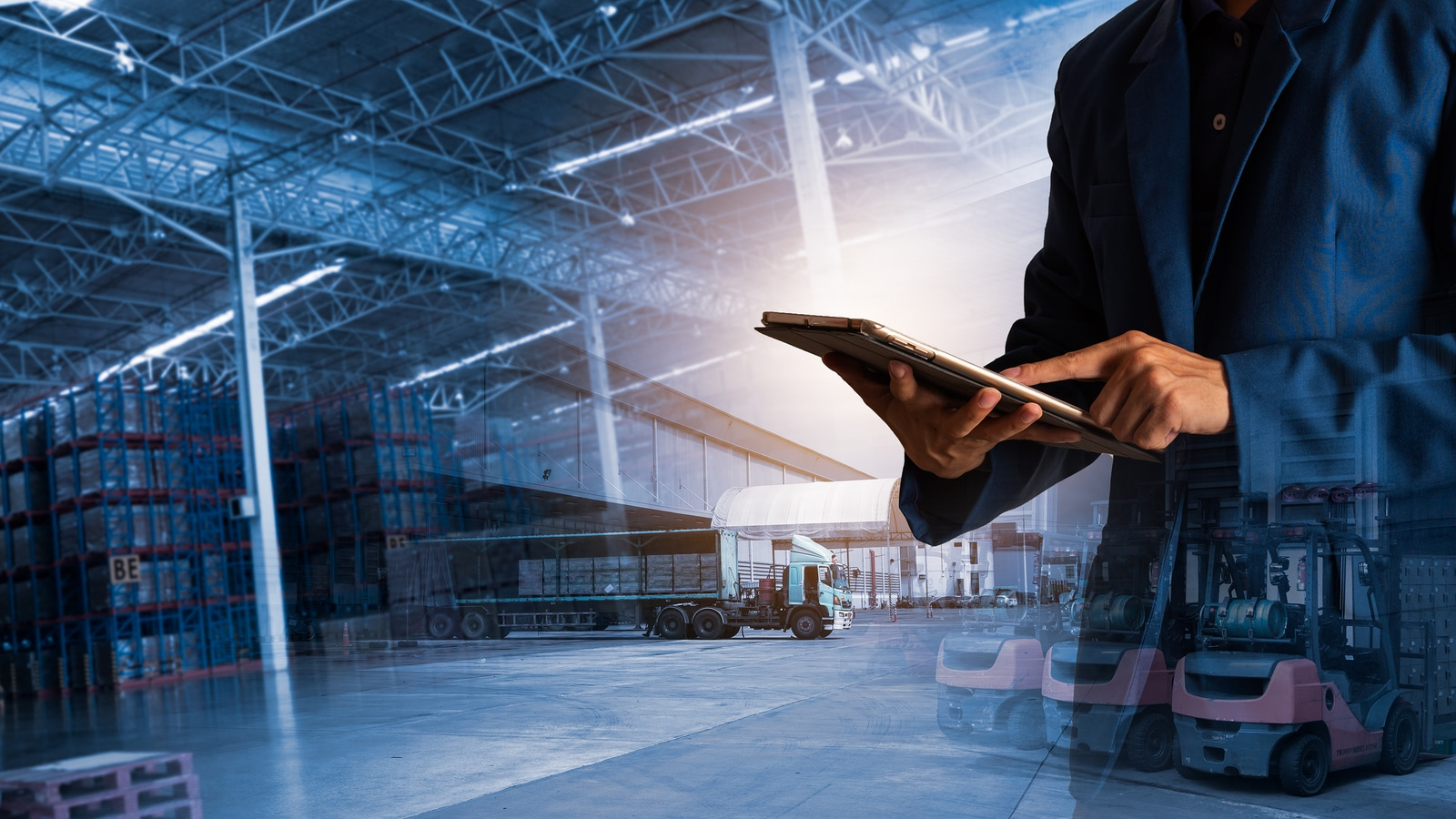 Businessman manager using tablet for warehouse logistics provider
